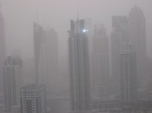 The Dubai Marina obscured by a sandstorm from my balcony.